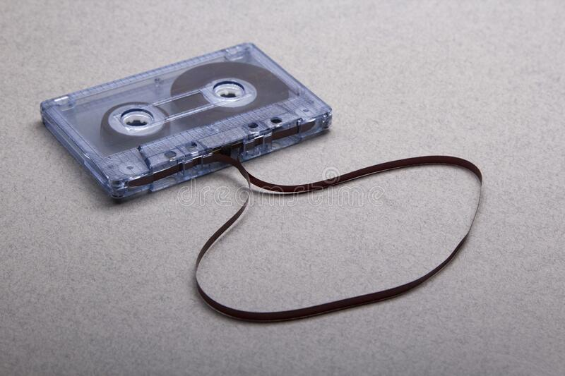 Cassette with removed tape on grey background royalty free stock photo