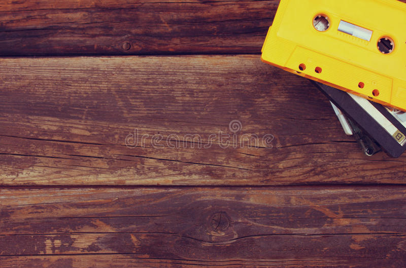 Cassette tapes over wooden table. top view. royalty free stock images