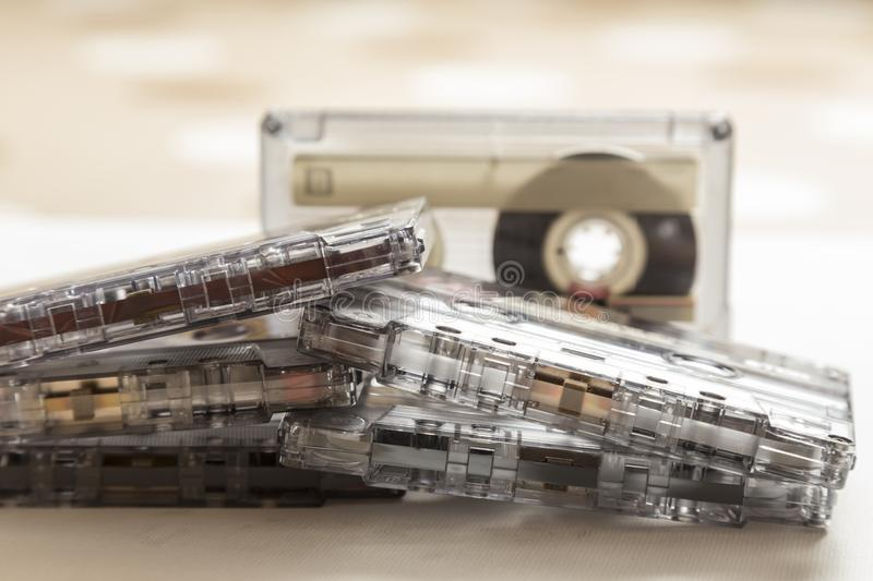 Cassette tapes piled up. View of several old cassette tapes, some with their boxes, in a heap stock photo