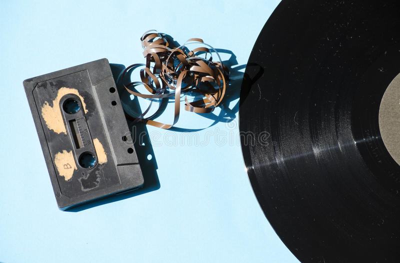 Cassette and vinyl record on a colored background stock photos