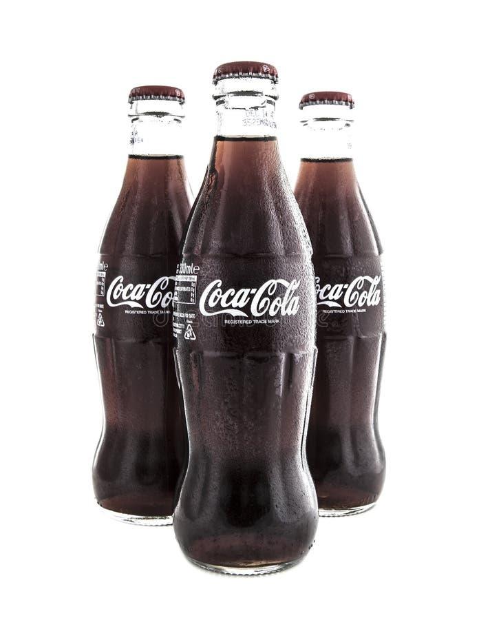 Cassic koka-koli butelki na Białym tle obraz royalty free