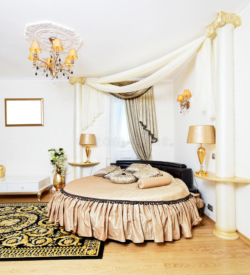 Cassical golden bedroom interior. With round bed stock photos