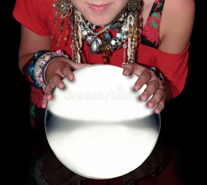 Cassiere di fortuna sopra una sfera di cristallo in bianco immagini stock libere da diritti