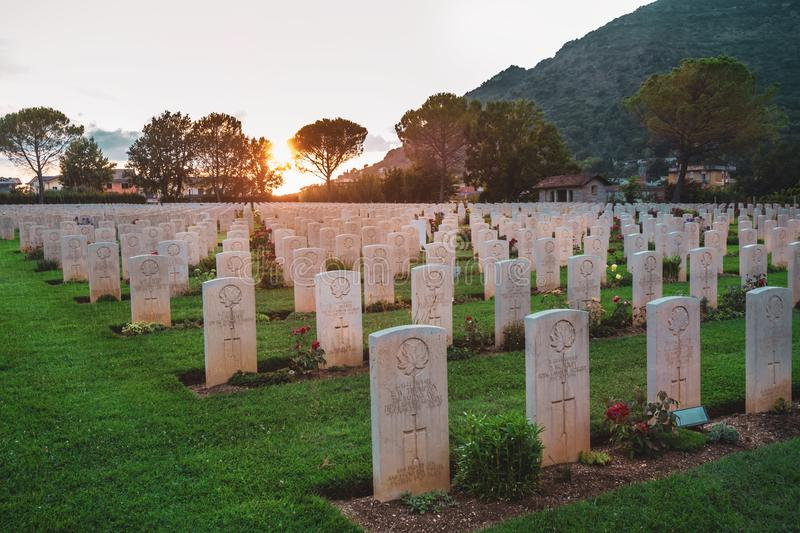 War memorial Canadian tombstones in Cassino, Italy. Cassino / Italy - August 17, 2019: War memorial Canadian tombstone with epitaph. Commonwealth Cemetery of stock images
