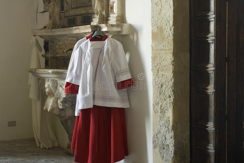 Cassock for altar boy. Enna cathedral stock photography