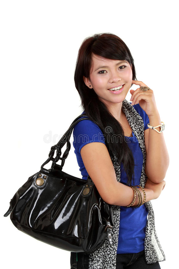 Cassual woman Carrying Bag. And smiling royalty free stock photos