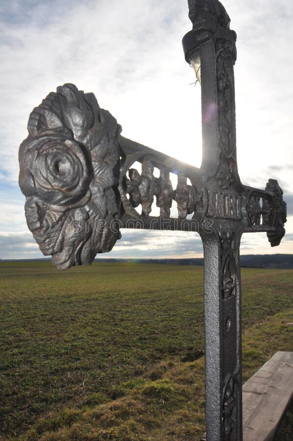 Cast iron cross. An old cast iron cross in the Pardubice Region in the Czech Republic stock image
