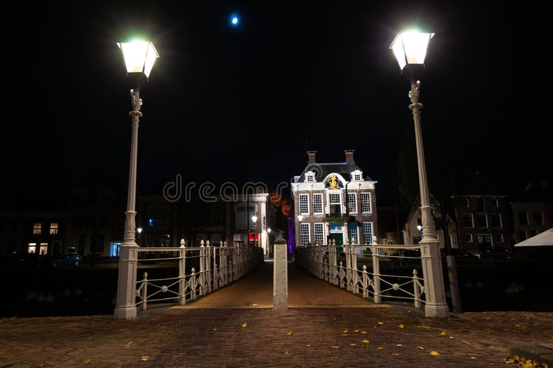 Cast iron forged bridge in the harbor with street lighting and o stock image