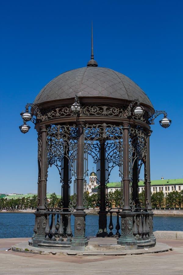 Cast-iron gazebo on the embankment of the Isetsky pond in Yekaterinburg in the Sverdlovsk region royalty free stock photo
