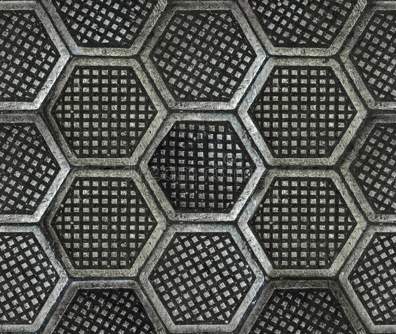 Cast iron hexagonal factory floor texture. Seamless texture of factory floor made of hexagonal cast iron tiles. Dirty, dark and old style royalty free stock images