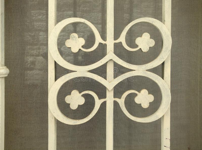 Cast iron ornament of cloves on bars four protecting a window stock photo