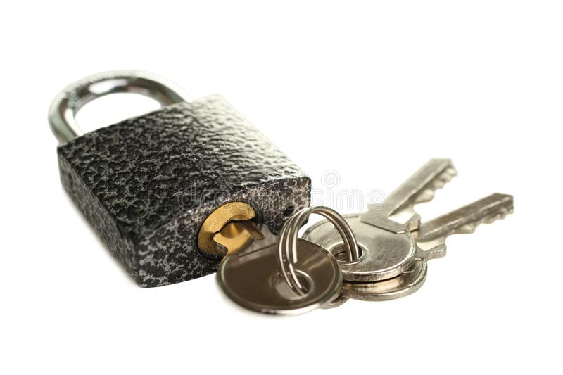 Cast iron padlock. With bunch of keys isolated on white. Concept security royalty free stock photography