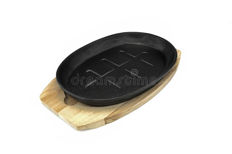 Cast Iron Serving Pan On Wood Plate White Isolated. New, Clean And Empty Cast Iron Serving Griddles Or Pan With Wood Plate Isolated On White Background stock photos