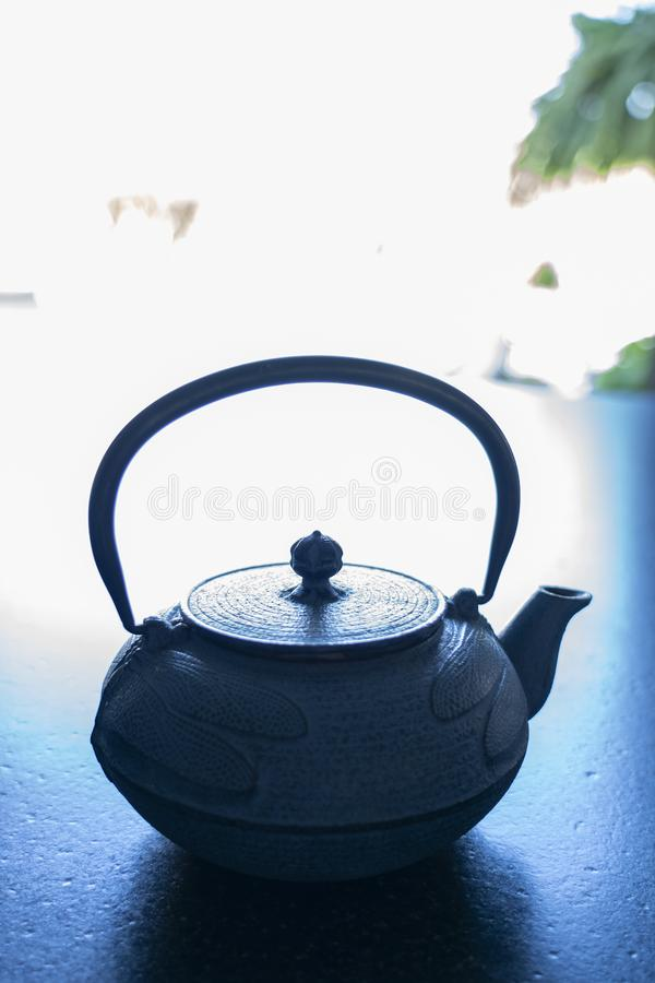 a cast iron tea pot on royalty free stock images