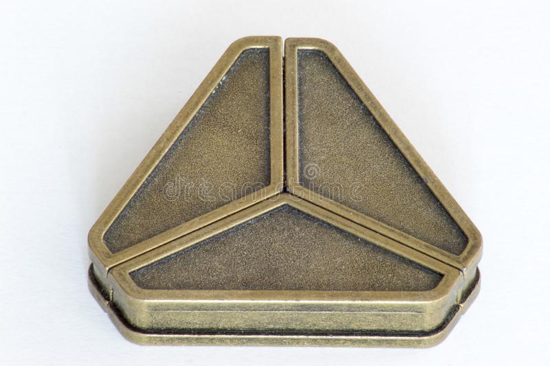 Cast iron triangle puzzle royalty free stock photo