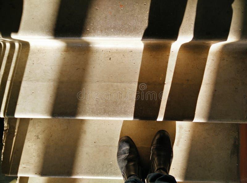 Cast Shadow on a flight of stairs at a low sun. Тень, отбрасываемая на лестничный пролёт при низком солнце stock image