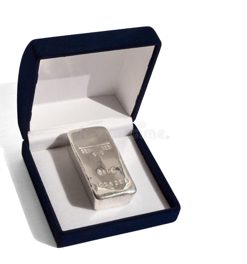 Cast silver bullion in a velvet gift box. royalty free stock photo