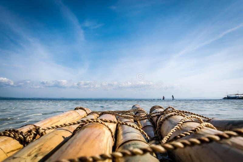 Castaway, on Pandanon Island, Mactan, Philippines. Castaway on a raft, on Pandanon Island, Mactan, Philippines stock photo