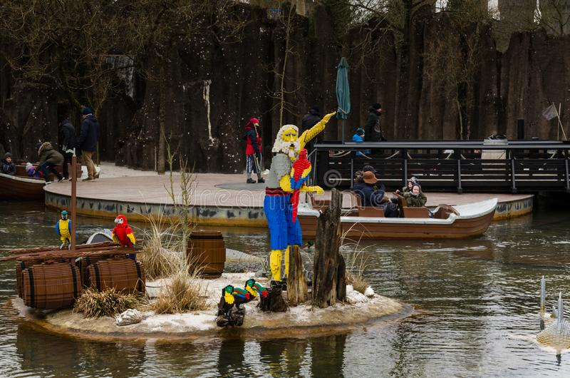 Castaway with a parrot made of Lego. Legoland Billund, Denmark - 03/31/2018 Castaway with a parrot made of Lego stock image