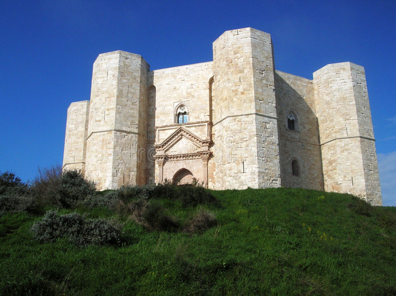 Castel del Monte. View of Castel del Monte, Andria - Italy - from the small street that climbs the hill stock photography