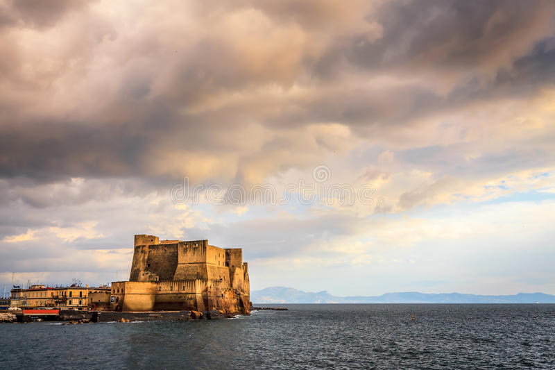 Castel dell'Ovo. (in Italian, Egg Castle) is a seaside castle located on the former island of Megaride, now a peninsula, on the Gulf of Naples in Italy. The stock photography
