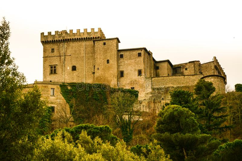 The castel on hill of soriano nel cimino and the autumn leafs stock photos