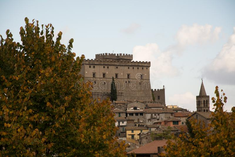 The castel on hill of soriano nel cimino and the autumn leafs royalty free stock photos