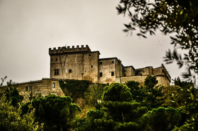 The castel on hill of soriano nel cimino and the autumn leafs royalty free stock image