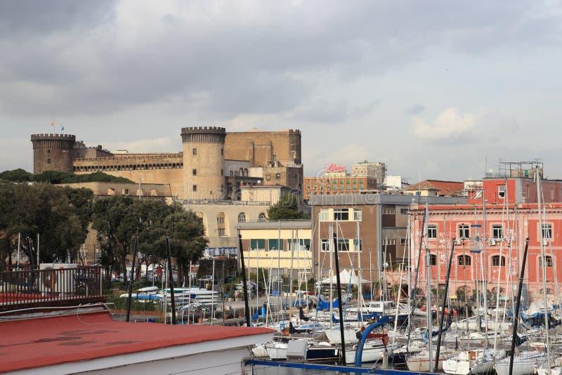 Castel nuovo från hamnen arkivbilder