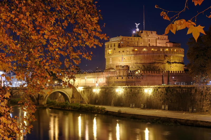 Castel Sant Angelo or the Mausoleum of Hadrian and Tiber River, at night - landmark attraction in Rome, Italy. Autumn background royalty free stock image
