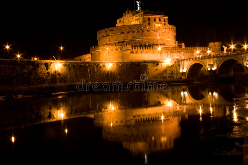 Castel Sant'Angelo at night. Castle Sant'Angelo at night with reflection of lights in river royalty free stock image