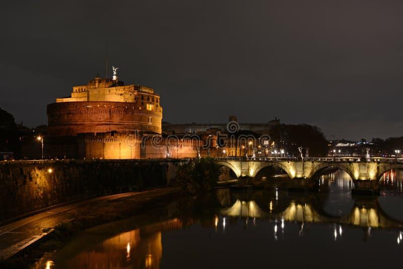 Castel Sant`Angelo and Ponte Saint Angelo bridge by night in Rome, Italy. Roman bridge italian landmark stock photography