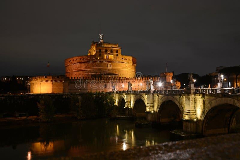 Castel Sant`Angelo and Ponte Saint Angelo bridge by night in Rome, Italy. Roman bridge italian landmark royalty free stock image