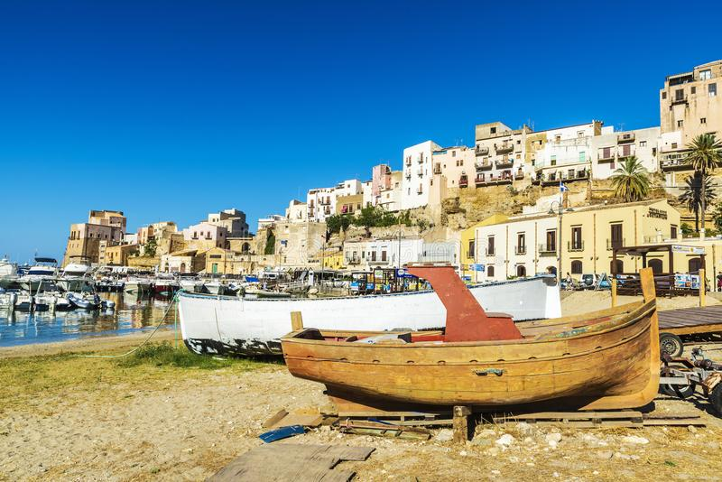 Old wooden fishing boat moored on the beach in Italy royalty free stock image