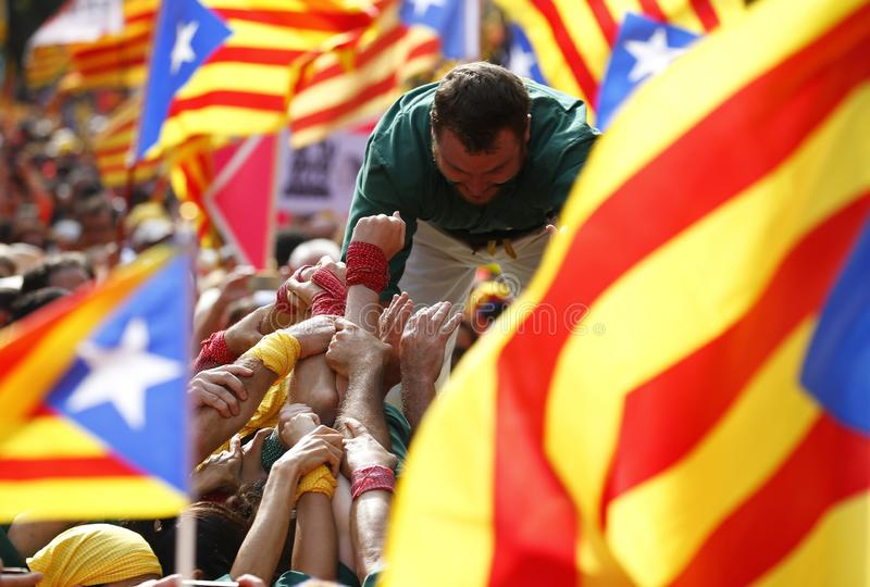 Castellers during Catalonia Diada in Barcelona Surrounded by Estelada flags stock photography