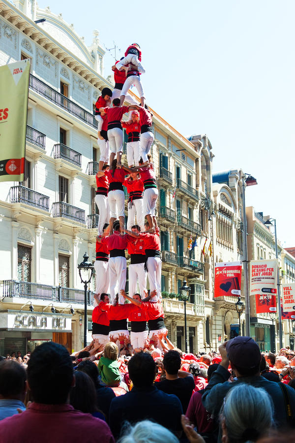 Castellers de Barcelona performers show during Can Jorba at avinguda Portal del Angel. BARCELONA, CATALONIA - APRIL 14: Castell show in April 14, 2013 in stock photos