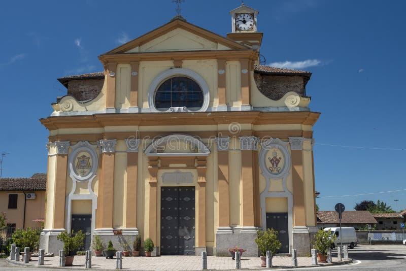 Historic church of Castello d`Agogna. Castello d`Agogna, Pavia, Lombardy, Italy: historic church in front of the castle stock photography