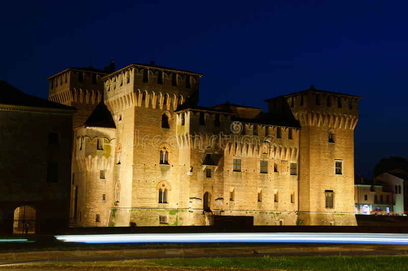 Castello di San Giorgio (Ducal Palace) in Mantua, Italy. Mantua, Italy - June 15, 2013: Castello di San Giorgio by night in Mantua, Italy. This castle was built royalty free stock images