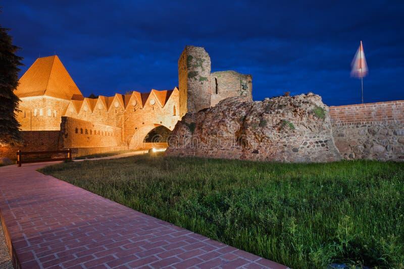 Castello teutonico dei cavalieri alla notte a Torum fotografie stock libere da diritti
