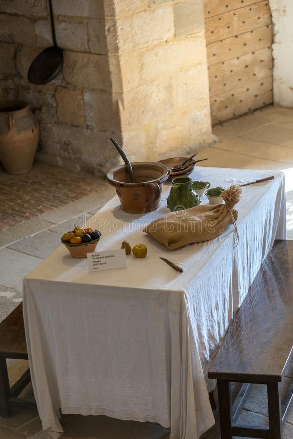 Atique interior of the kitchen in Castelnaud Castle, medieval fortress at Castelnaud-la-Chapelle, Dordogne, Aquitaine, France stock photography