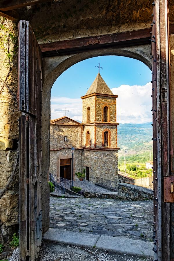 Castelnuovo at national park Cilento. Picturesque shot of historic village Castelnuovo at the Cilento national reserve in Italy. The medieval door opens for its stock photography