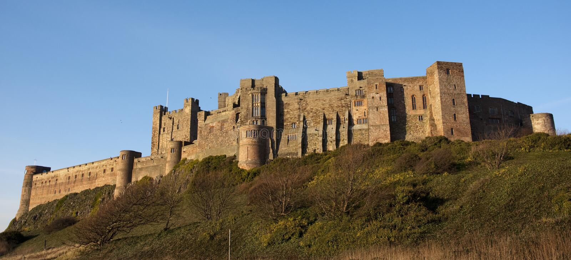 Castelo de Bamburgh em Northumberland fotos de stock royalty free