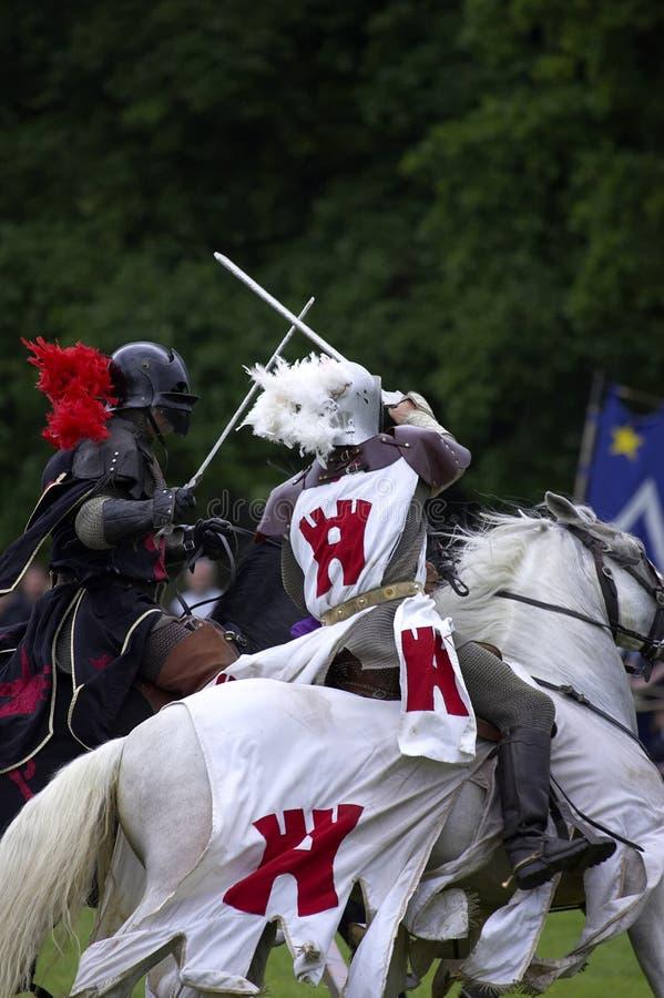 Castelo jousting Inglaterra Reino Unido do warwick dos cavaleiros foto de stock royalty free