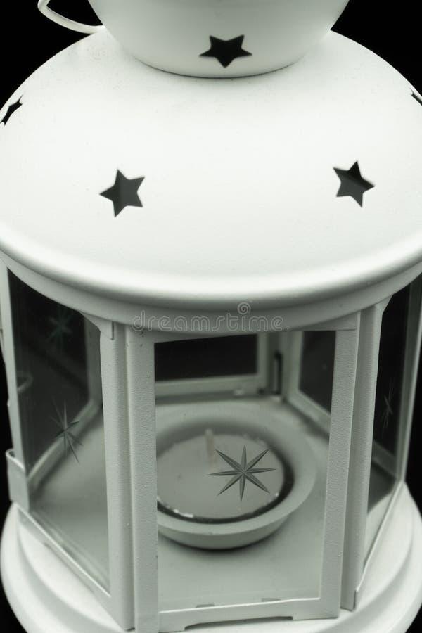 Castiçal branco com estrelas e vela fotografia de stock