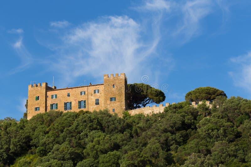Castiglione della Pescaia. Castle on the top of the hill in Castiglione della Pescaia stock image