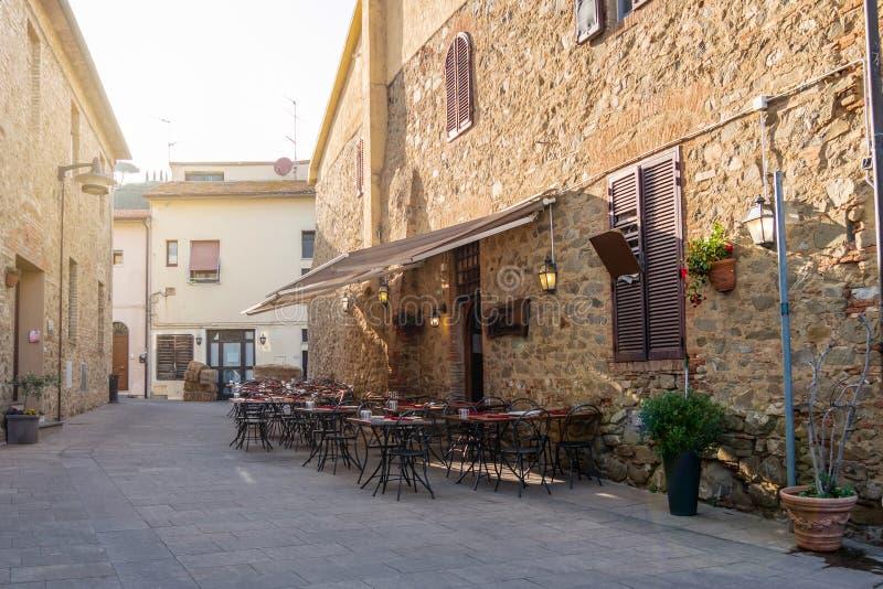Castiglione della Pescaia, Grosseto, Tuscany, Italy - Aprile 2018: Old Town of Castiglione della Pescaia at sunset royalty free stock image