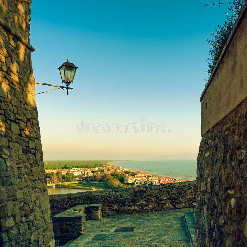 Castiglione della Pescaia, lamp and terrace sunset view on the s. Ea and beach. Maremma, Tuscany, Italy stock photo