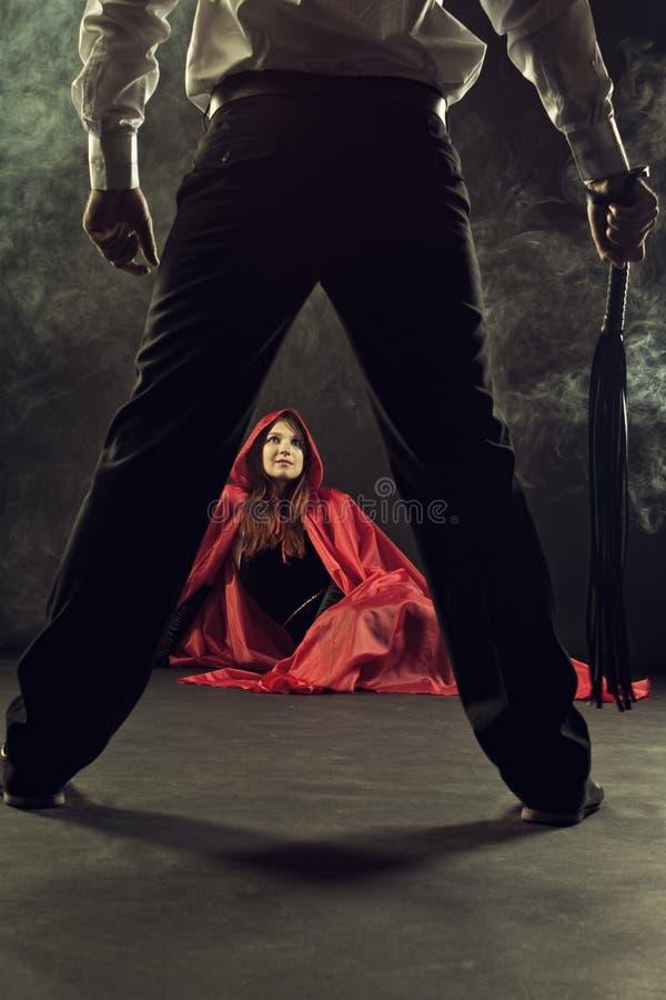 Castigo de la capa con capucha roja foto de archivo libre de regalías