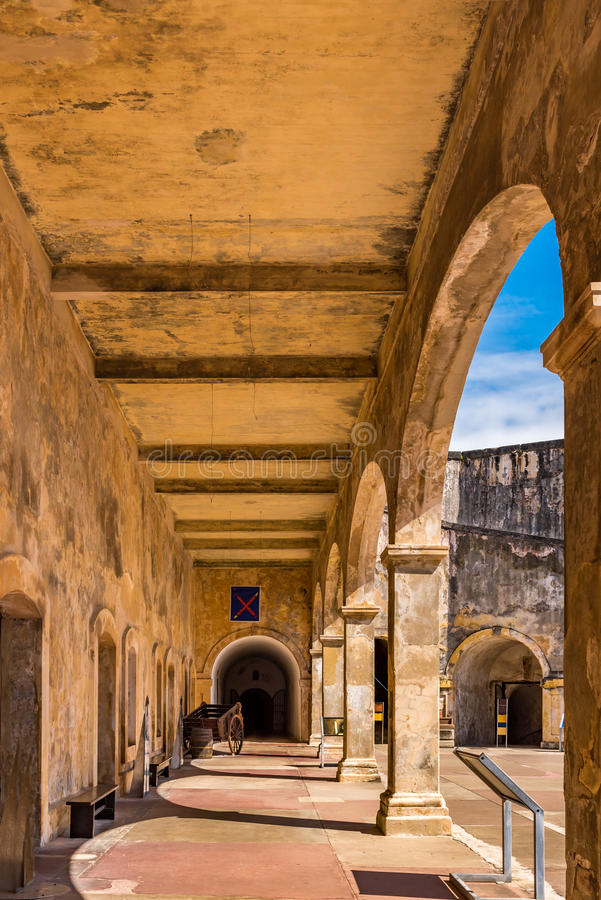 Castillo de San Cristobal corridor with arches. And a wagon barrel royalty free stock photo
