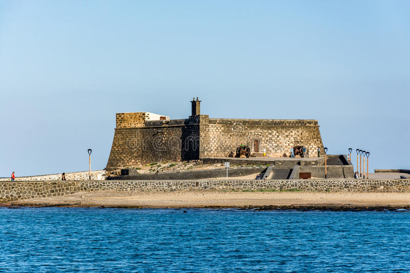 Castillo de San Gabriel - Saint Gabriel Castle in Arrecife and a cannon in front of it royalty free stock photos